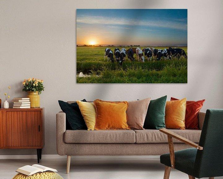 Sfeerimpressie: Zonsondergang met koeien in de polder van Martin Bredewold