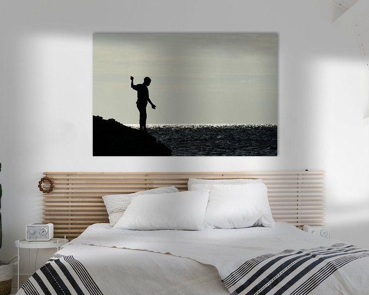 Sfeerimpressie: Jongen op rotsen aan het vissen van Christopher Lewis