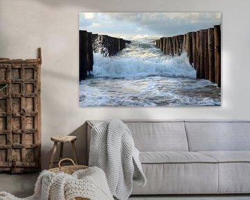 Welle gegen den Pfahlkopf von Oostkapelle Fotografie