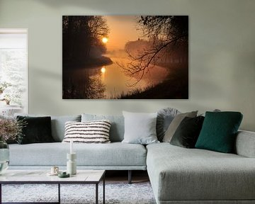 Misty rising sun van Robert Fischer