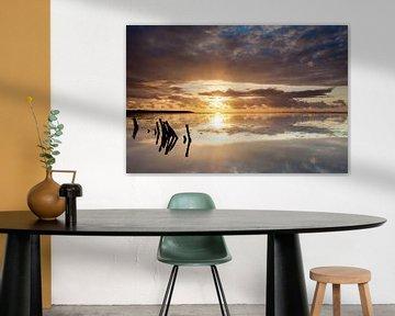 Gouden zonsondergang op het wad von Ron Buist
