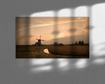 Molen bij zonsondergang in Volendam van Chris Snoek