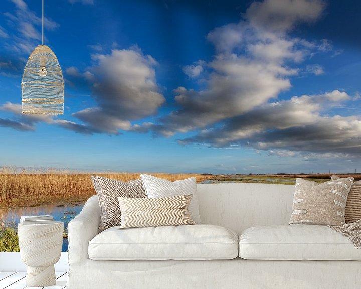 Sfeerimpressie behang: Wolkenpartij boven de Onlanden, Groningen van Koos de Wit
