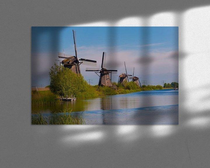 Sfeerimpressie: Windmills in a row at Kinderdijk Holland van Brian Morgan