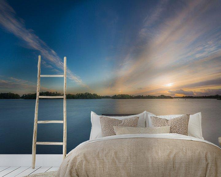 Sfeerimpressie behang: Zonsondergang op een steiger van Koos de Wit