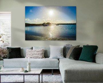 Bateau de pêche au coucher du soleil dans la baie de Sint Joris à Curaçao sur Joke Van Eeghem