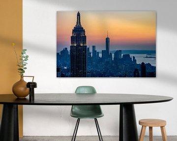 Lower Manhattan skyline  bij zonsondergang van Joran Maaswinkel