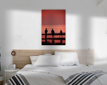 Silhouetten met zonsondergang van Peter Schütte