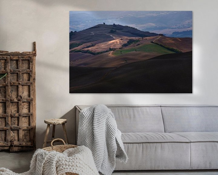 Sfeerimpressie: De heuvels in Toscane met mooie warm kleuren van Steven Dijkshoorn