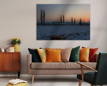 Een winterse zonsondergang van Maurice Hertog