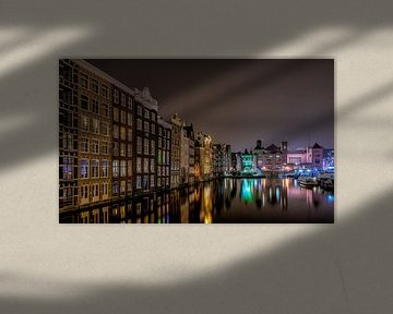 Damrak Amsterdam in de avond von Mario Calma