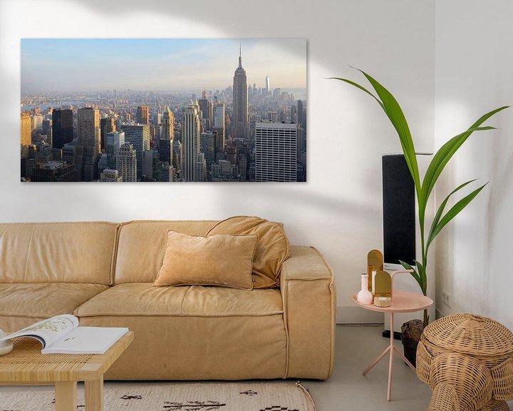 Sfeerimpressie: Manhattan New York met het Empire State Building voor zonsondergang, panorama van Merijn van der Vliet
