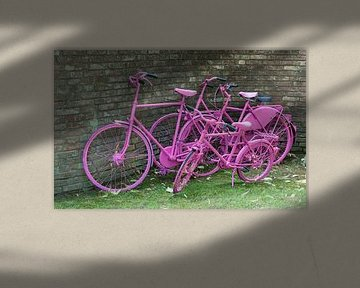 pink painted bikes and old wall