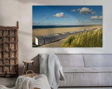 Strandhuisjes op het strand bij Vrouwenpolder van René Weijers