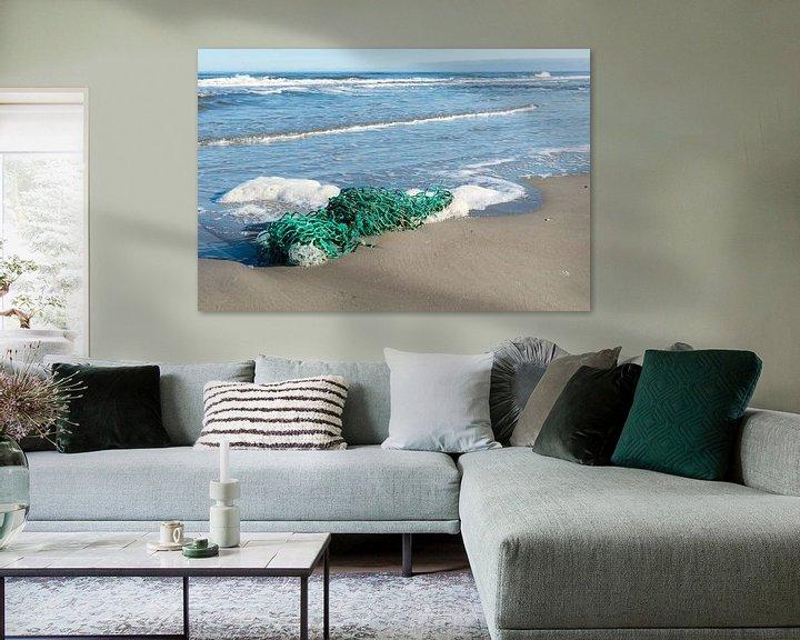 Sfeerimpressie: Groen vissersnet op het strand van Tonko Oosterink