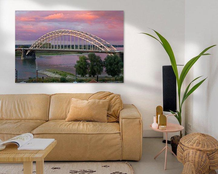 Sfeerimpressie: Waalbrug te Nijmegen met een mooie lucht van Anton de Zeeuw