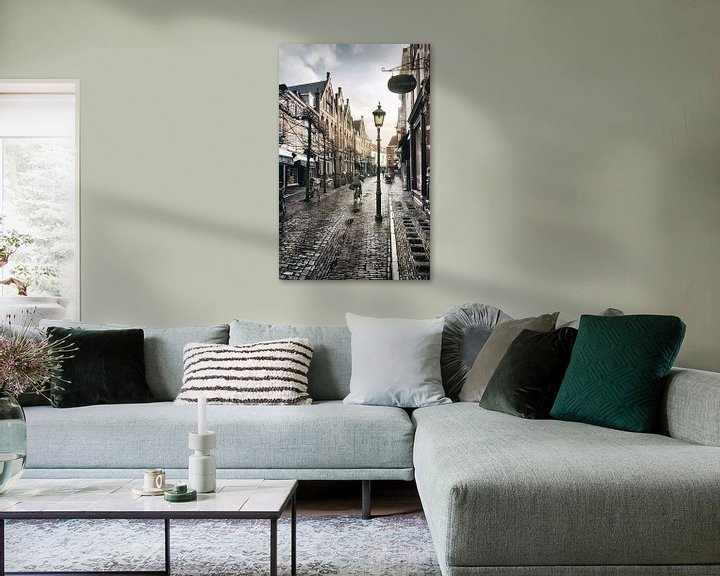 Sfeerimpressie: Haarlem: Warmoesstraat na de bui. van Olaf Kramer