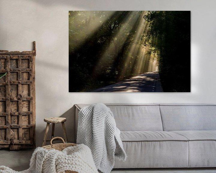 Sfeerimpressie: Zonnestralen over weg  van Arthur Wolff