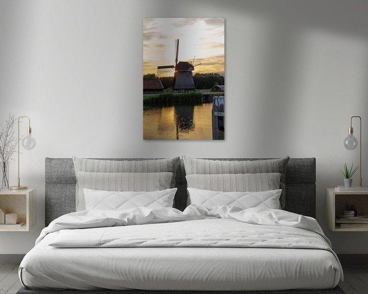 Sfeerimpressie: Hollandse Molen in Zonsondergang van Paul Franke