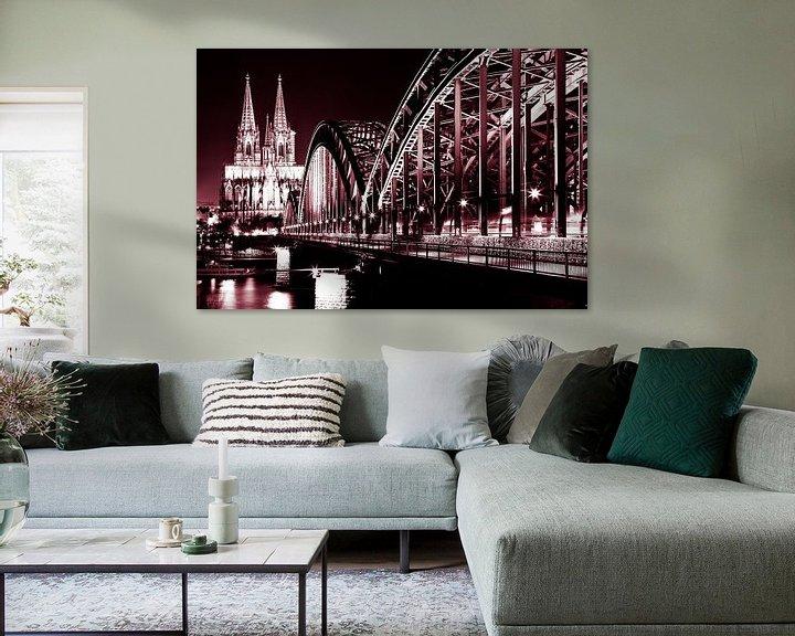 Sfeerimpressie: De dom in Keulen met de Rijnbrug. van Karel Pops