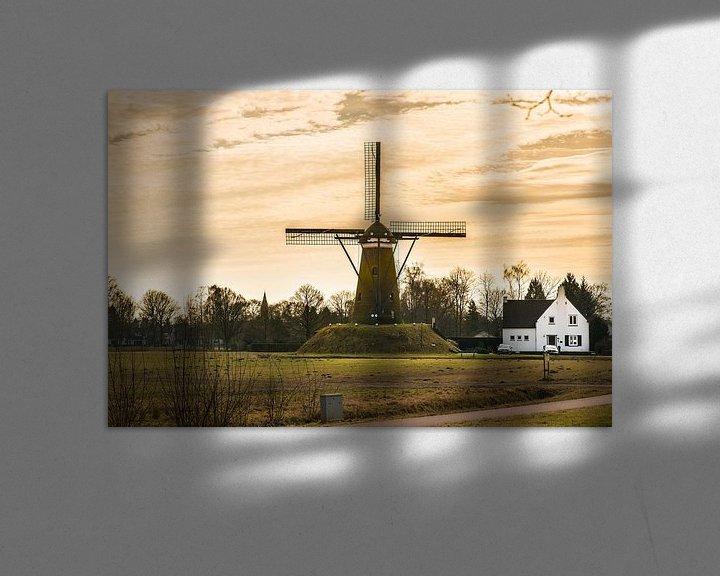 Sfeerimpressie: A Dutch Windmill with A yellow sky van Brian Morgan