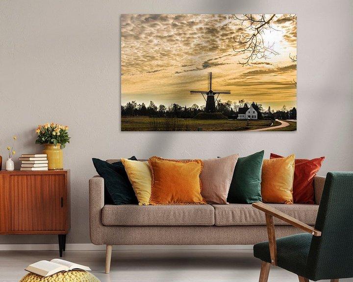 Sfeerimpressie: A Dutch windmill in evening light van Brian Morgan