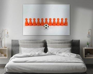 Conceptuele oranje speelpionnen als voetbalelftal sur Tonko Oosterink
