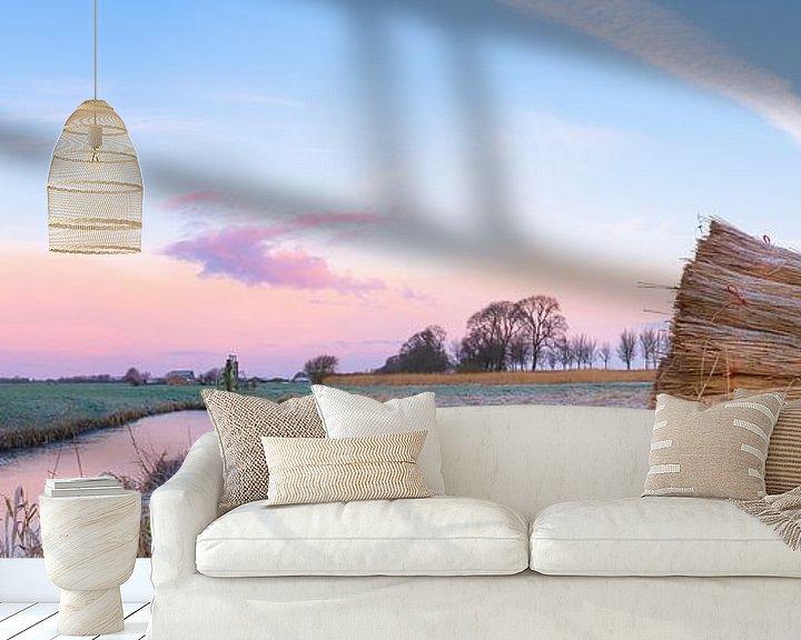 Sfeerimpressie behang: Zonsopkomst in een winters landschap in de IJsseldelta van Sjoerd van der Wal
