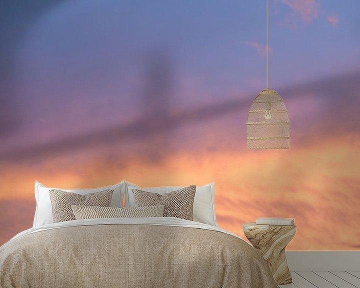 Sfeerimpressie behang: Zonsondergang, wolkenlucht van Ronald Smits