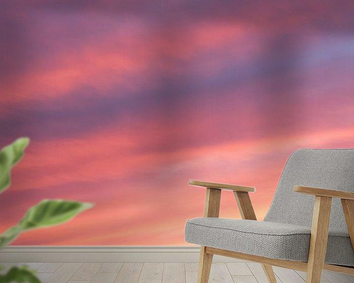 Sfeerimpressie behang: Zonsondergang met rode, paarse, gele en oranje kleuren van Ronald Smits