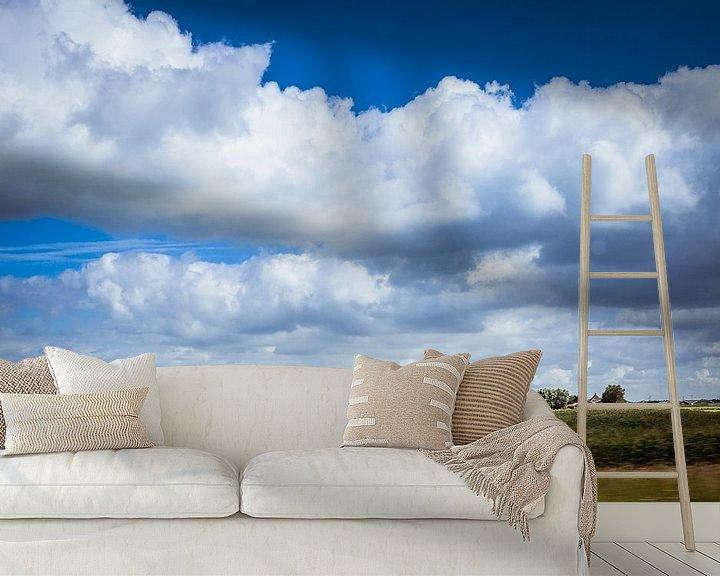 Sfeerimpressie behang: Dutch clouds van Freddy Hoevers