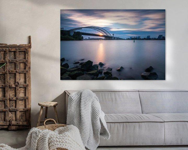 Sfeerimpressie: Zonsondergang bij de Brienenoordbrug van Ilya Korzelius