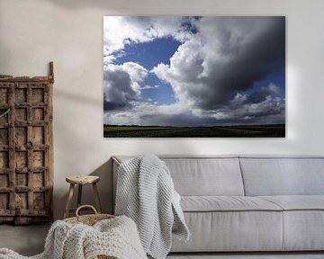 Wolkenstraat over Noord-Holland van Cora Unk