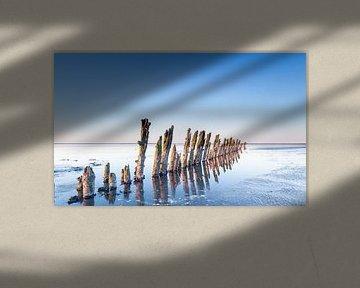 Reflectie van de paaltjes op de Waddenzee nabij Moddergat sur Martijn van Dellen