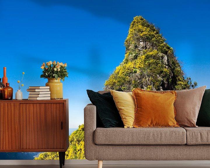 Sfeerimpressie behang:  Bergtop bedekt met gele bloemen van Michel van Kooten