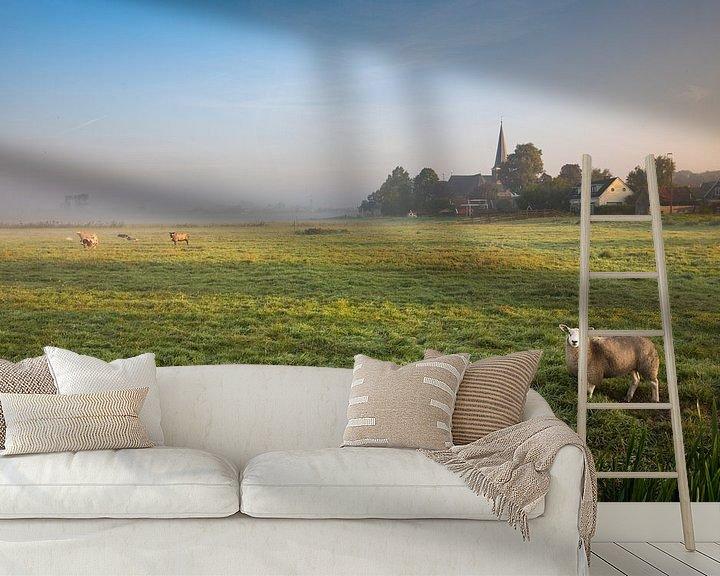 Sfeerimpressie behang: Hollands nevelig landschap met grazendeschapen en een typisch nederlandse wolkenlucht. Wout Kok One2 van Wout Kok