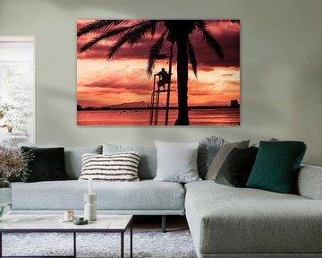Strandwacht bij zondsondergang
