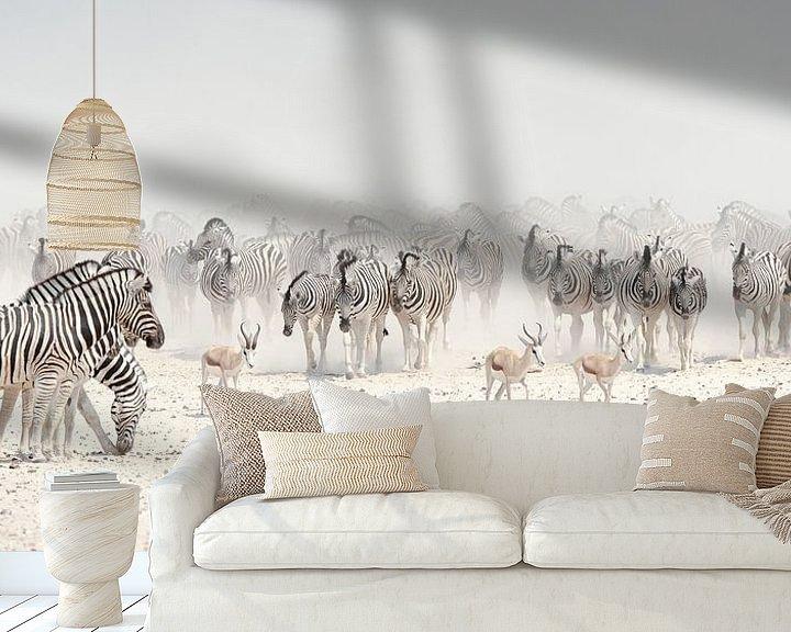 Sfeerimpressie behang: zebrakudde op de zoutpan van  Etosha van margreet van vliet