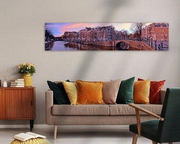 Panorama van de stad Amsterdam bij zonsondergang von Nisangha Masselink