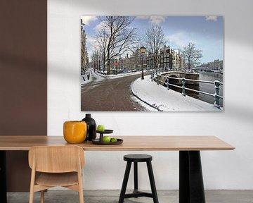 Besneeuwd Amsterdam in de winter in Nederland von Nisangha Masselink