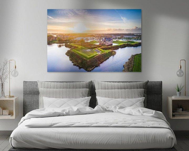 Sfeerimpressie: Muiderslot tijdens Zonsondergang (luchtfoto) van Frenk Volt