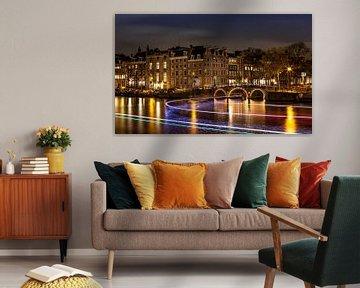 Lichtstralen door de Amsterdamse grachten von René Rollema