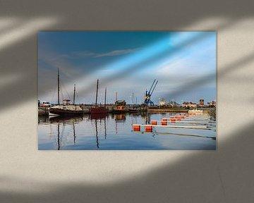 View to the city port of Rostock van Rico Ködder
