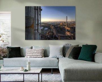 Verlaten industrie bij zonsondergang von Steve Mestdagh