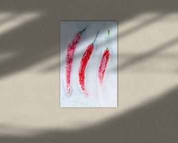 Rode pepers op ijs. van Hennnie Keeris