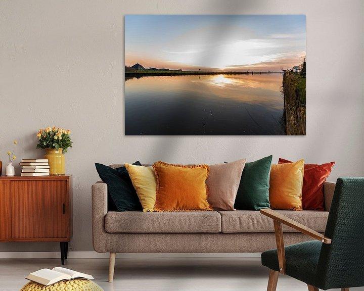 Sfeerimpressie: Zonsondergang over het water van Brian Morgan