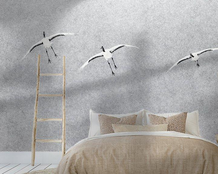 Sfeerimpressie behang: Chinese Kraanvogels vliegend in sneeuwbui van AGAMI Photo Agency