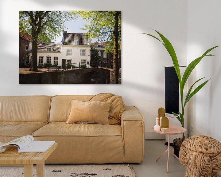 Sfeerimpressie: Old house alongside a bridge and canal in Amersfoort, Netherlands van Daniel Chambers