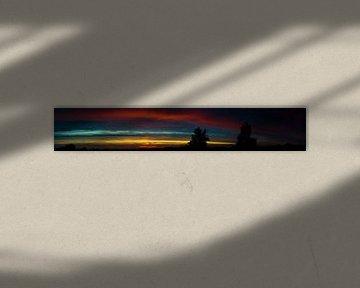 Photo panoramique d'un coucher de soleil coloré