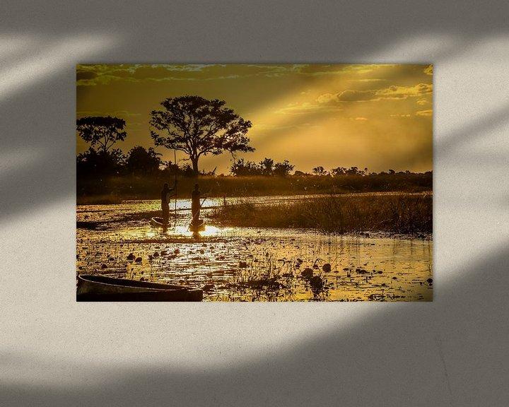 Sfeerimpressie: Schitterende zonsondergang en traditionele mokoro's in de  Okavango Delta, Botswana van Original Mostert Photography